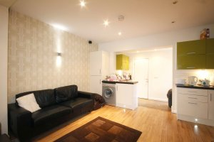 Stylish lime green kitchen area and sofa in our student accommodation
